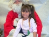 Girl with Santa at BP High Childcare 2006 008.jpg