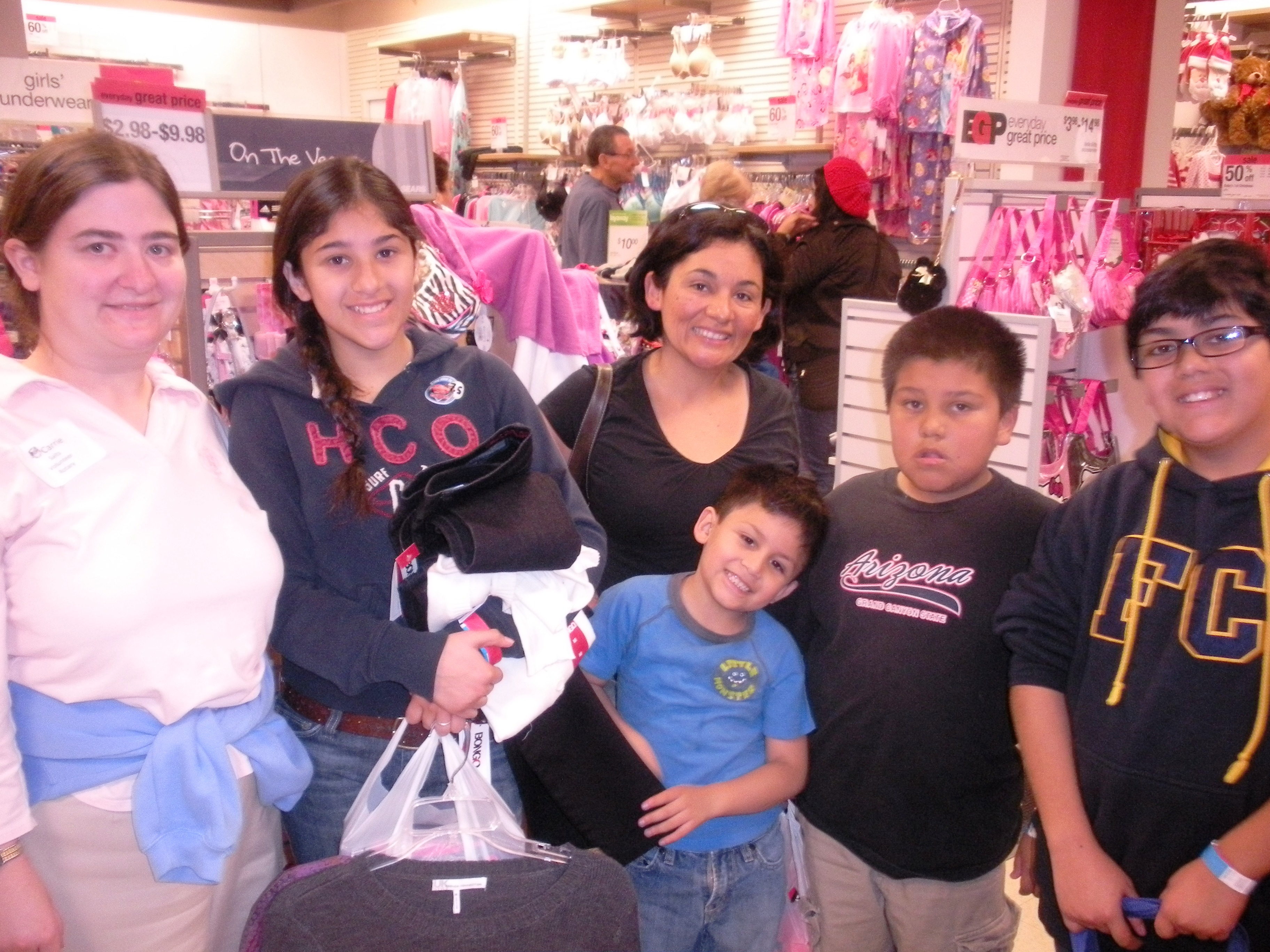 Carrie Salts shops with a Mom and four kids.JPG