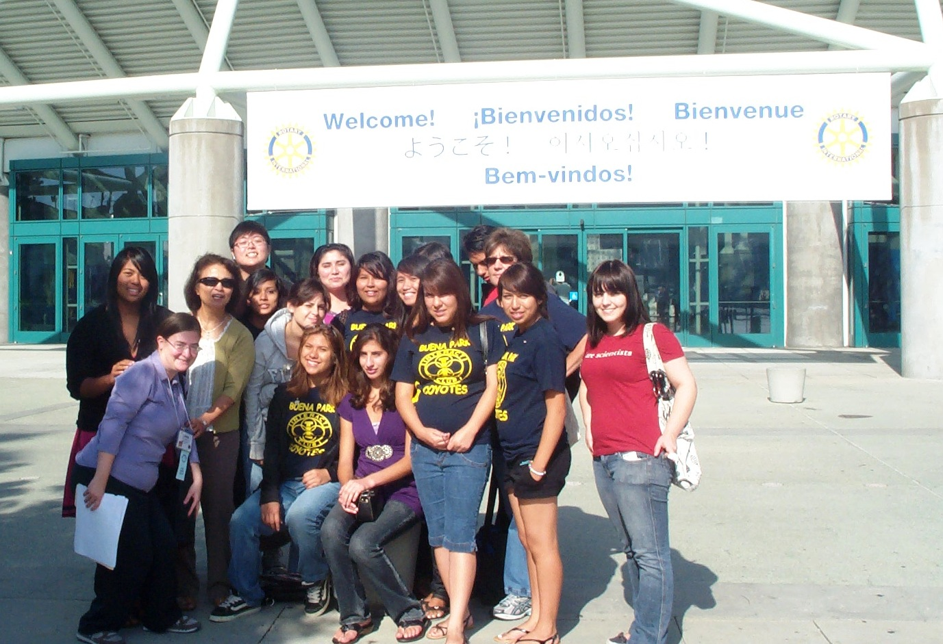 Welcome sign with Interactors and Carrie.JPG