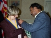 Web Shailesh Gives Pin to Shailesh Shah pins Citizen of the year Donna Miller 003.JPG
